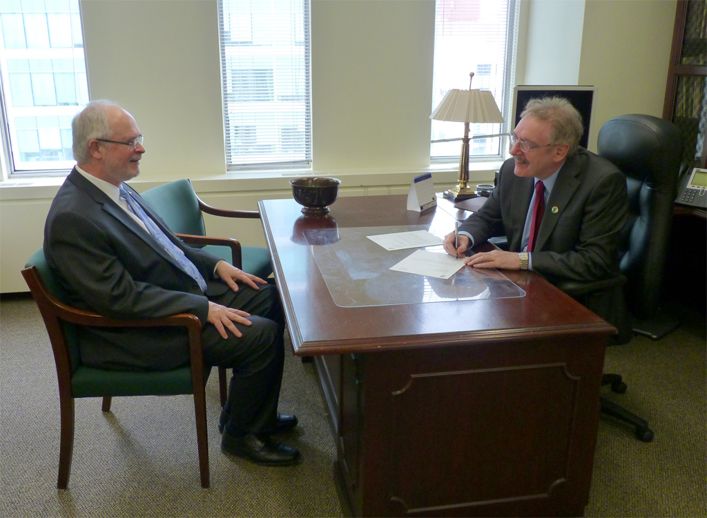 Irish Ambassador to Canada Dr Ray Bassett signs appointment documents for Stephen Fogarty as Honorary Legal Advisor to the Embassy